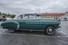 1950 chevrolet deluxe coupe. Image is shot a rainy afternoon in July 2013 at the fish market in Halden, Norway stock photos