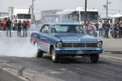 Chevrolet drag car in action on the track Royalty Free Stock Photo