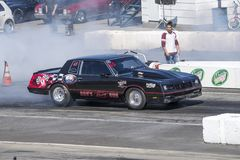 Chevrolet drag car at the starting line making a smoke show Stock Photo