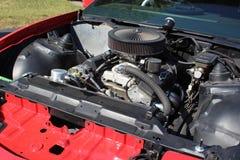 Chevrolet Engine in a Rebuilt 1987 Pontiac Firebird Formula. A Chevrolet engine has been placed into a rebuilt 1987 Pontiac Firebird Formula car Stock Images
