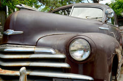 1948 Chevrolet Fleetline Aerosedan Coupe. Front driver side view of a rusty old 1948 Chevrolet Fleetline Aerosedan Coupe Stock Photo