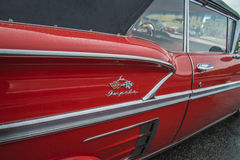 1958 chevrolet impala convertible, detail rear fender Royalty Free Stock Photo