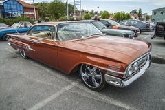 1960 Chevrolet Impala 2 Door Hardtop. Every Wednesday during the months of May to August there is a veteran car meeting with American cars at the fish market in Stock Photo