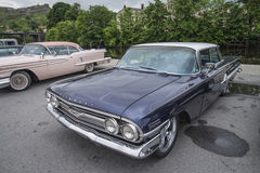 1960 Chevrolet Impala 4-Door Hardtop Sedan. Every Wednesday during the months of May to August there is a veteran car meeting with American cars at the fish Royalty Free Stock Images