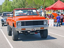 Chevrolet K-5 Blazer. This is a 1970's era orange Chevrolet K-5 Blazer with a lifted suspension, after market wheels, and off-road tires royalty free stock photo