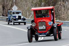 1927 Chevrolet LM Flat Bed Truck driving on country road. Adelaide, Australia - September 25, 2016: Vintage 1927 Chevrolet LM Flat Bed Truck driving on country Stock Photos