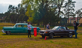 Chevrolet and mercedes before speed test. Start of speed test of an old Chevrolet and Mercedes 380 SE during old car race in Wejherowo, Poland Stock Photos
