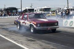 Chevrolet nova burnout at the starting line Stock Photos