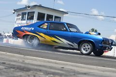 Chevrolet nova making a smoke show at the starting line Stock Image