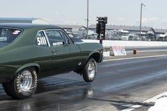 Chevrolet nova making a wheelie Stock Photo