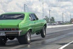 Chevrolet nova making a wheelie Royalty Free Stock Photos