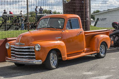 1950 Chevrolet pickup truck. Sanair september 6-7, 2014 picture of nice orange 1950 chevy pickup truck, short bed, single cab, chrome grill and bumper. during stock photos