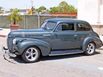 1939 Chevrolet. This is a restored 1939 Chevrolet sedan with some nice custom touches including a metallic gunmetal gray paint job and chrome spoke wheels stock photos