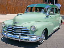 1947 Chevrolet Sedan. This is a well maintained, two toned 1947 four door Chevrolet with an optional sun visor, spotlight, and hubcaps stock images