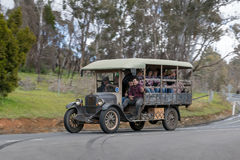 1926 Chevrolet Series V Charabanc driving on country road. Adelaide, Australia - September 25, 2016: Vintage 1926 Chevrolet Series V Charabanc driving on country Royalty Free Stock Image