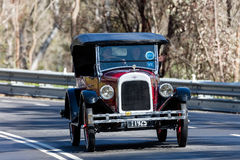1925 Chevrolet Superior K tourer. Adelaide, Australia - September 25, 2016: Vintage 1925 Chevrolet Superior K tourer driving on country roads near the town of Stock Photos