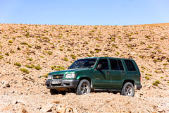 Chevrolet Trooper. ANTOFAGASTA, CHILE - NOVEMBER 16, 2015: Green off-road car Chevrolet Trooper at the country road Stock Image
