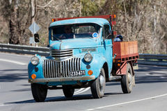 1946 Chevrolet 1421 Truck driving on country road. Adelaide, Australia - September 25, 2016: Vintage 1946 Chevrolet 1421 Truck driving on country roads near the Stock Photography