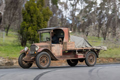 1927 Chevrolet Utility Truck driving on country road Stock Photo