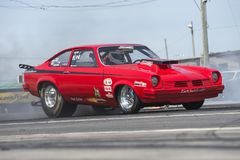 Drag racing. Front side view of red Chevrolet vega drag car making a burnout Stock Photo