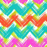 Chevron pattern hand painted with brushstrokes. Vector seamless chevron pattern hand painted with bold brushstrokes in bright multiple colors can be used for Stock Photo