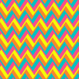 Chevron pattern from shifted  multicolored zigzags. Royalty Free Stock Images