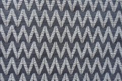 Chevron pattern woven into grey fabric Stock Images