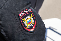 Chevron on the sleeve uniforms of the russian policeman. SAMARA, RUSSIA - APRIL 24, 2016: Chevron on the sleeve uniforms of the russian policeman stock images