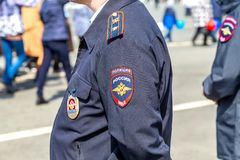 Chevron on the sleeve uniforms of the russian policeman. Samara, Russia - May 1, 2019: Chevron on the sleeve uniforms of the russian policeman stock image