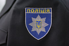 Chevron ukrainian policeman in uniform with the inscription Royalty Free Stock Images