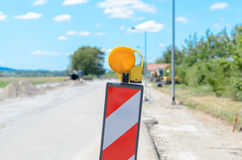 Chevron and warning light for roadworks Royalty Free Stock Photo