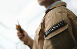 Chevron with word SECURITY on guard`s uniform on light background, closeup