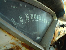Chevy Antique or retro speedometer on rusty dashboard Stock Photos
