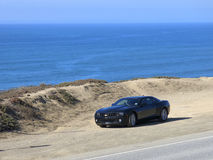 Chevy Camaro on beach in California Stock Photo