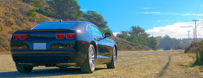 Chevy Camaro in Big Sur, California Immagine Stock