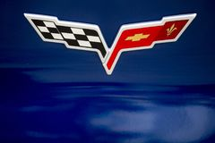 Chevy Corvette Emblem. The classic Chevrolet Corvette insignia on a deep blue Corvette sports car Royalty Free Stock Photography