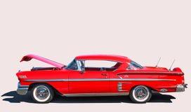 Chevy Impala 1957 på en vit bakgrund Fotografering för Bildbyråer