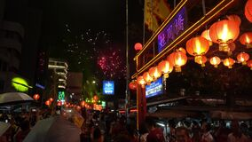 Chew Jetty entrance. Firework show at stage during Hokkien Chinese New Year.