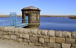 Chew reservoir water tower. Chew reservoir above the village of Greenfield, on Saddleworth Moor in Greater Manchester royalty free stock photos
