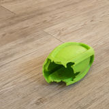 Chewed rugby rubber dog toy Stock Image