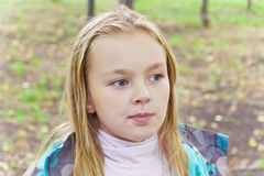 Chewing cute girl. Photo of chewing cute girl with blond hair royalty free stock image
