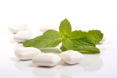 Chewing gum. And fresh leaves of mint Stock Photo
