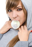 Chewing gum. Young woman with chewing gum isolated on white Stock Photography