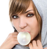Chewing gum. Young woman with chewing gum isolated on white Stock Photo