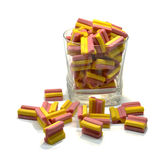 Chewing gum in the glass. Pink and orange chewing gum in the glass glass. And a small number of scattered near the glass Stock Photography