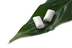 Chewing gum on a green leaf Royalty Free Stock Photo