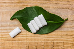 Chewing gum is on a leaf Royalty Free Stock Image