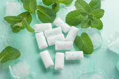 Chewing gum with mint and ice. Dental closeup medicine cold herbal smell dentist spearmint fresh healthy whitening sugar food breath bubblegum tasty hygiene stock image