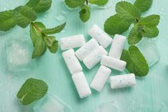Chewing gum with mint and ice. Dental closeup medicine cold herbal smell dentist spearmint fresh healthy whitening sugar food breath bubblegum tasty hygiene stock images