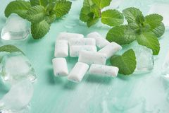 Chewing gum with mint and ice. Dental closeup medicine cold herbal smell dentist spearmint fresh healthy whitening sugar food breath bubblegum tasty hygiene royalty free stock photo